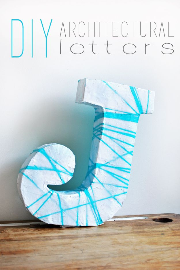 diy 3 d architectural letters made with dixie cups scissors glue