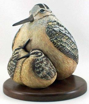 """""""Woodcock Mama with Babies,"""" carved out of an odd-shaped gourd growing through a fence!"""