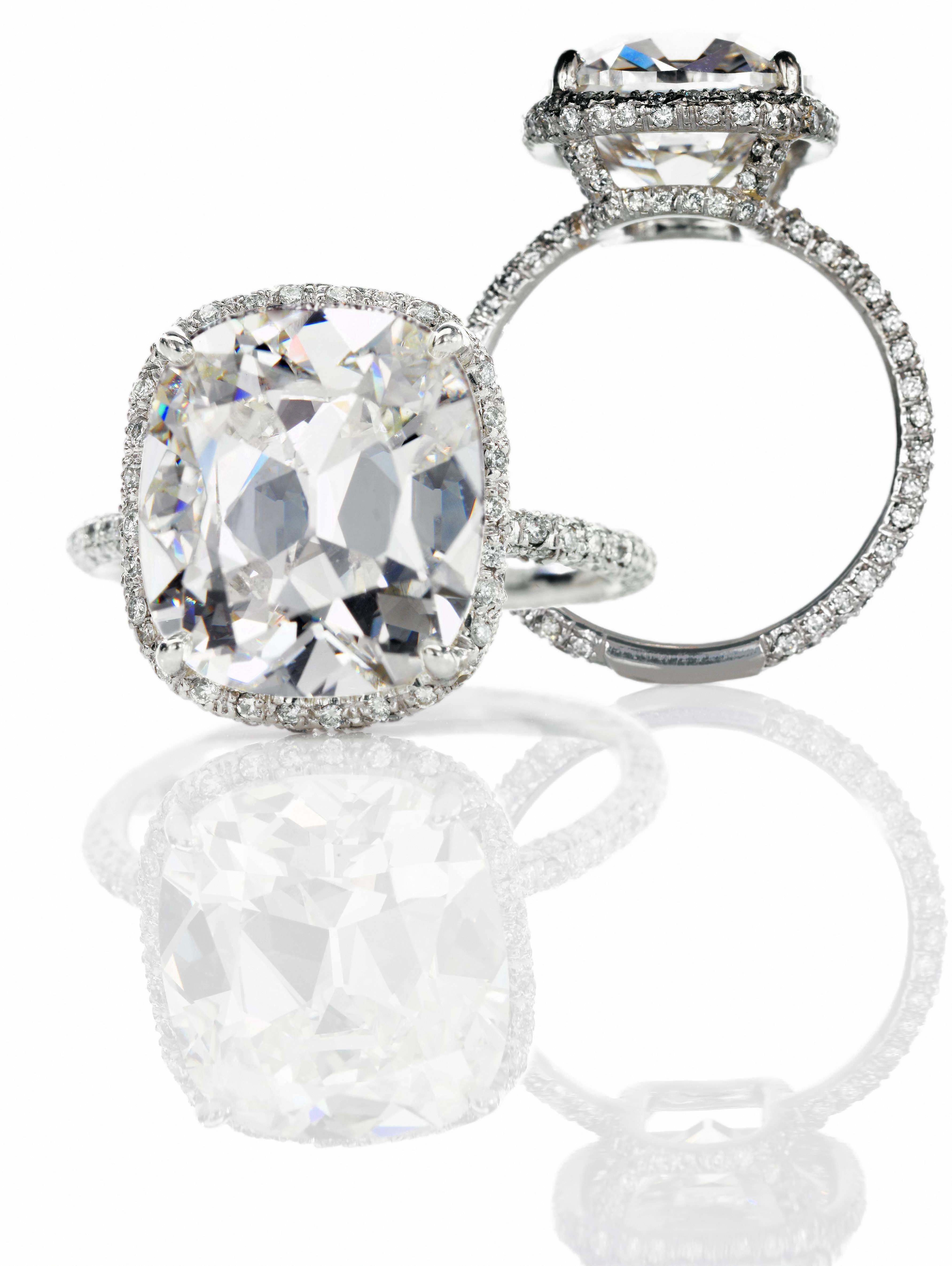 Cushion cut center stone tiny micro pave halo diamonds around