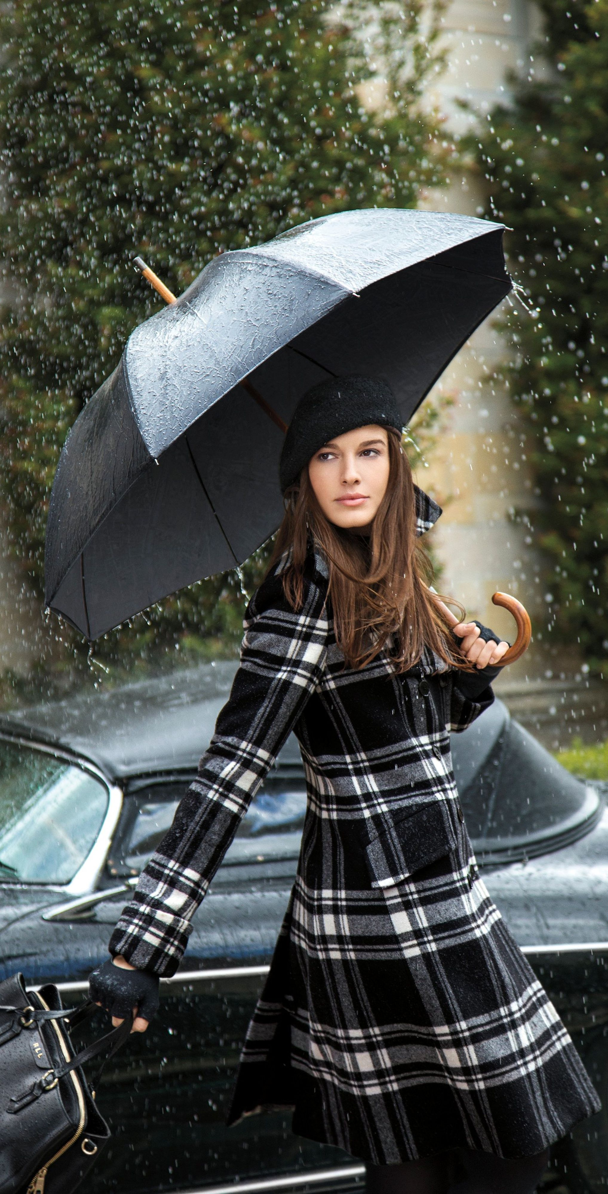 Update your look with Lauren Ralph Lauren classics in sleek shades of black, white and grey. This warm coat is crafted from an ultra-soft wool blend and features a preppy plaid pattern with a  classic double-breasted silhouette