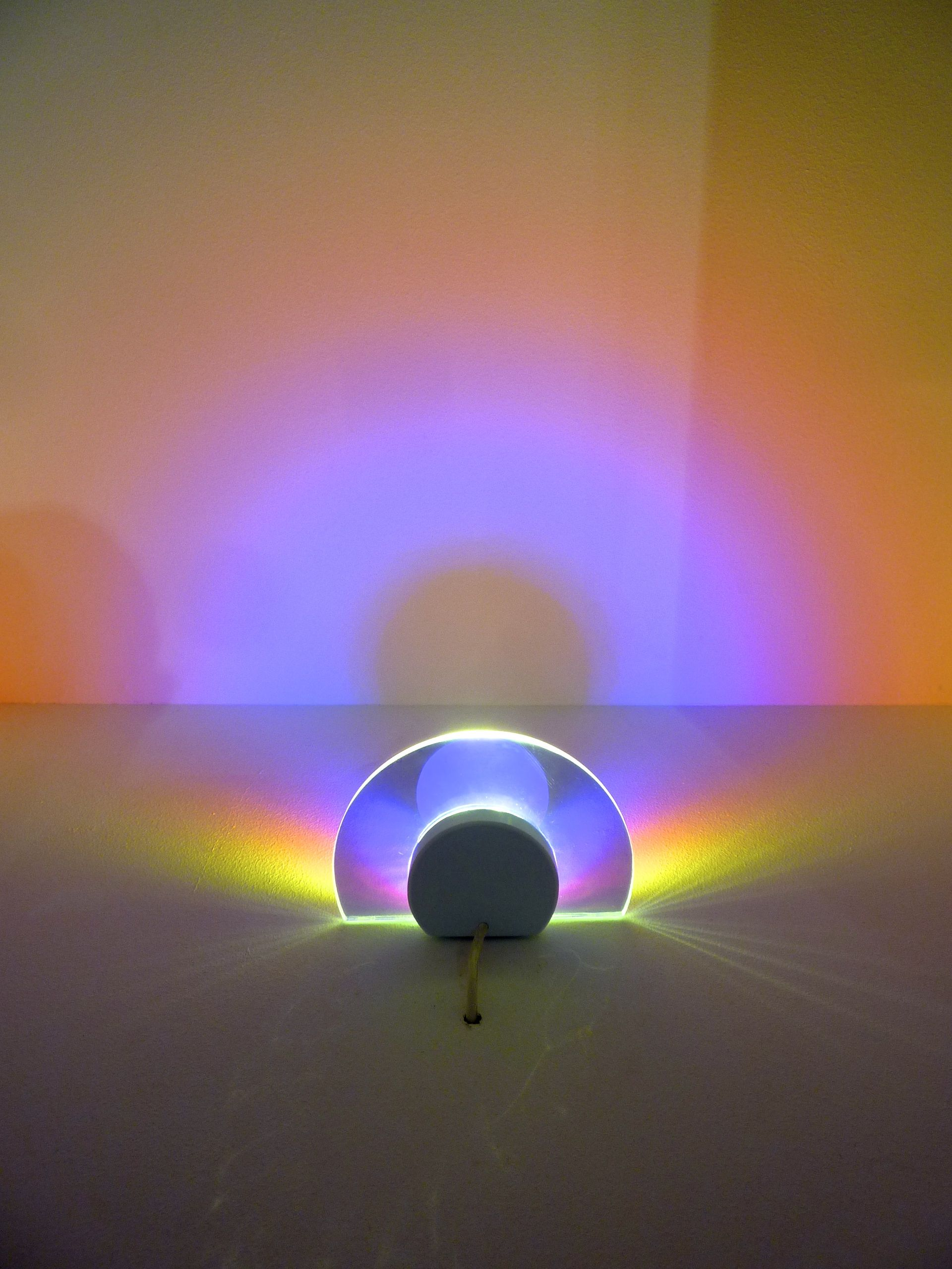 """Lamp """"Helios"""" by Arturo Erbsman from France, projects the illusion of sunset on a wall. Photo by Milou Ket"""