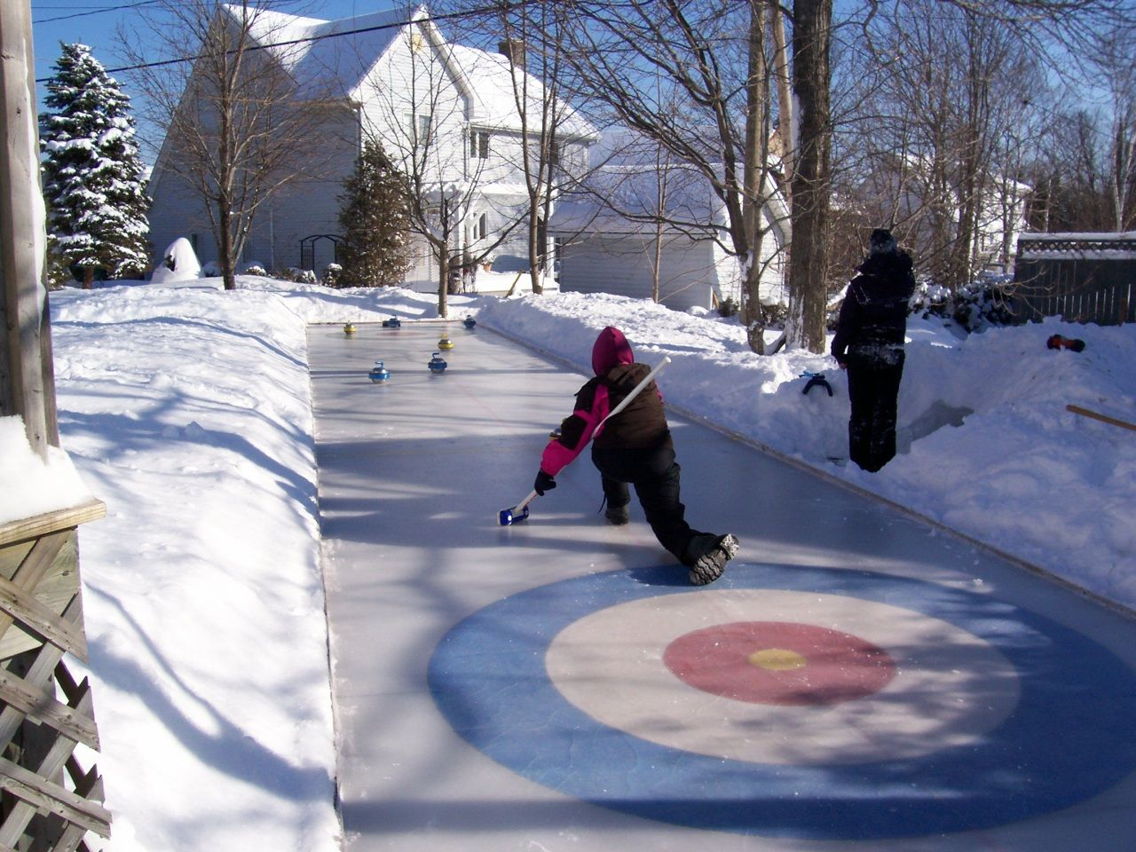 Homemade outdoor curling rink ... I would be ALL about ...