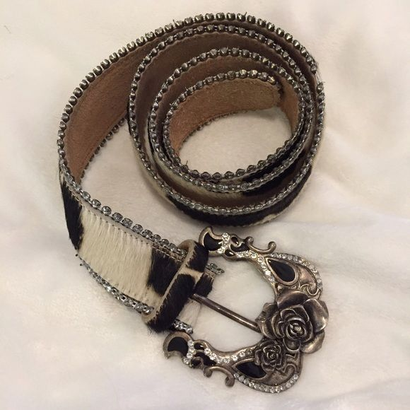 Betsey Johnson cow hair leather rhinestone belt This belt is gorgeous! Rhinestones line the belt. Only a couple missing. Beautiful buckle with roses.  5 belt holes. Belt is 44 inches long.  Cow hair on outside leather inside. Betsey Johnson Accessories Belts