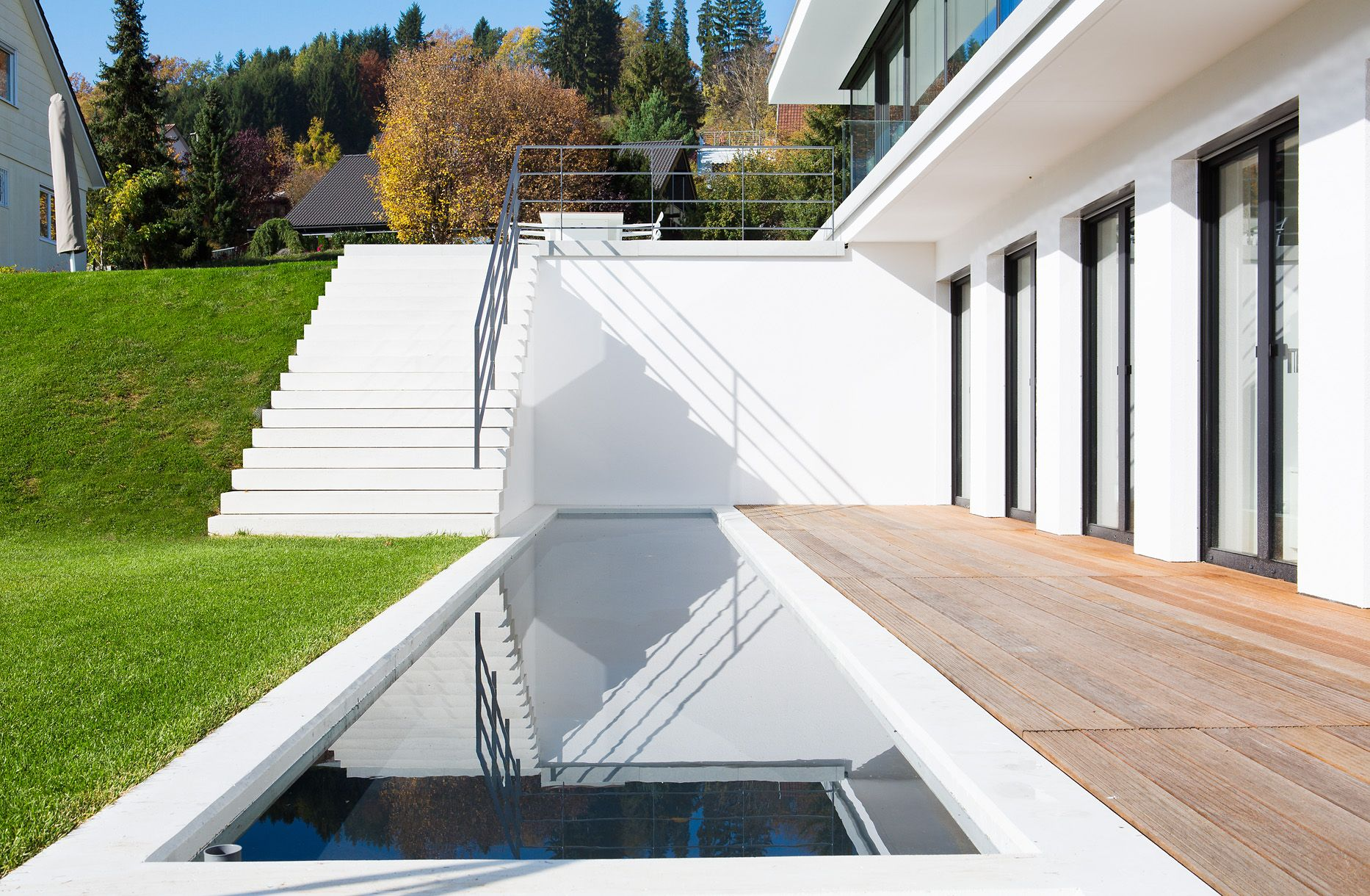 A shallow pool draws a waterline in the garden level, right infront of the private rooms.