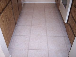 This ceramic tile kitchen floor has been restored to looking brand ...