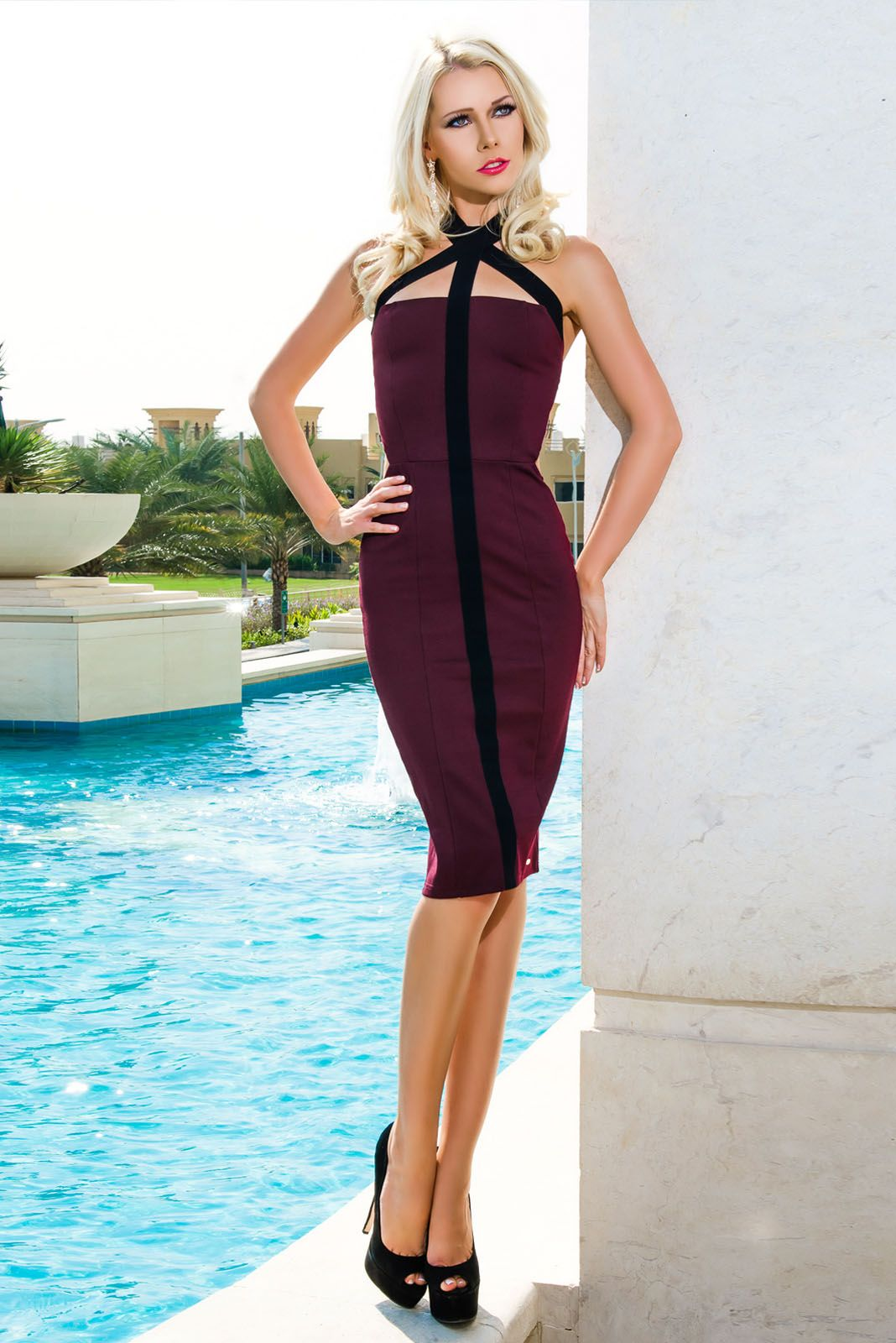 Turn heads in this burgundy backless dress with an unusual halter neckline.