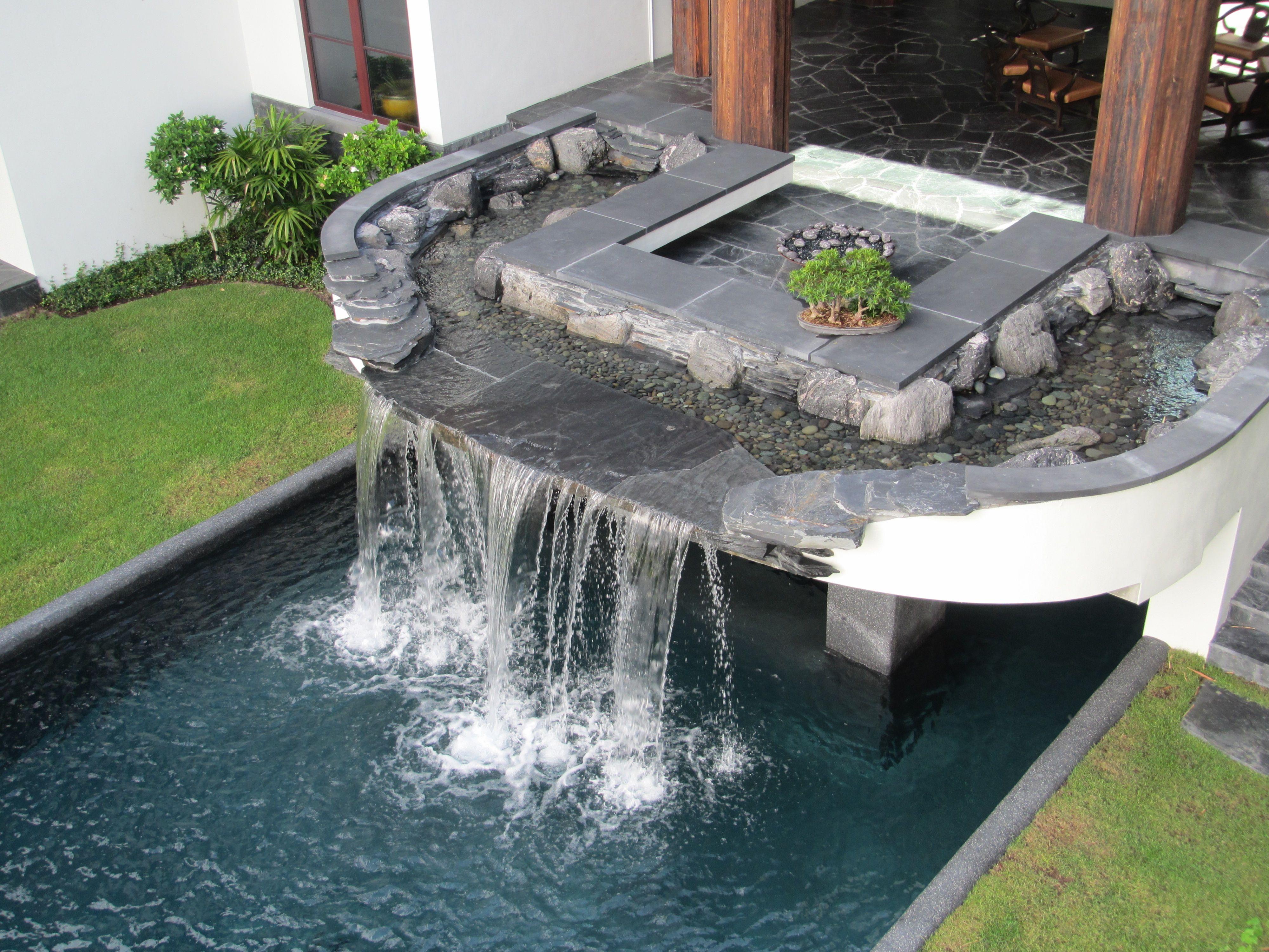 Pool Waterfall In Manalapan Florida The Stone Is Black 400 x 300