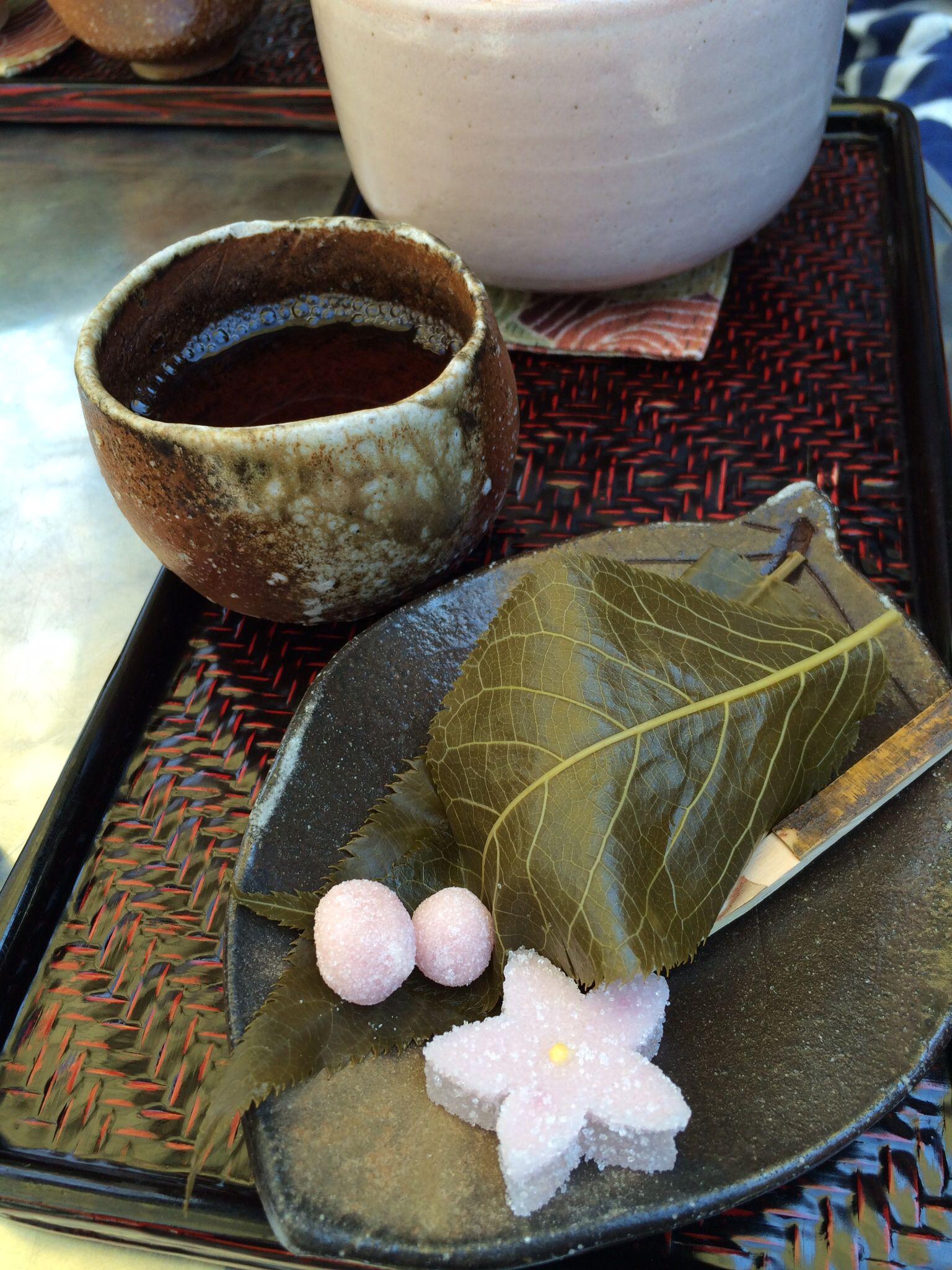 Photo of Mochi in Sakura leaf. Green tea. Philosophers walk. Kyoto.