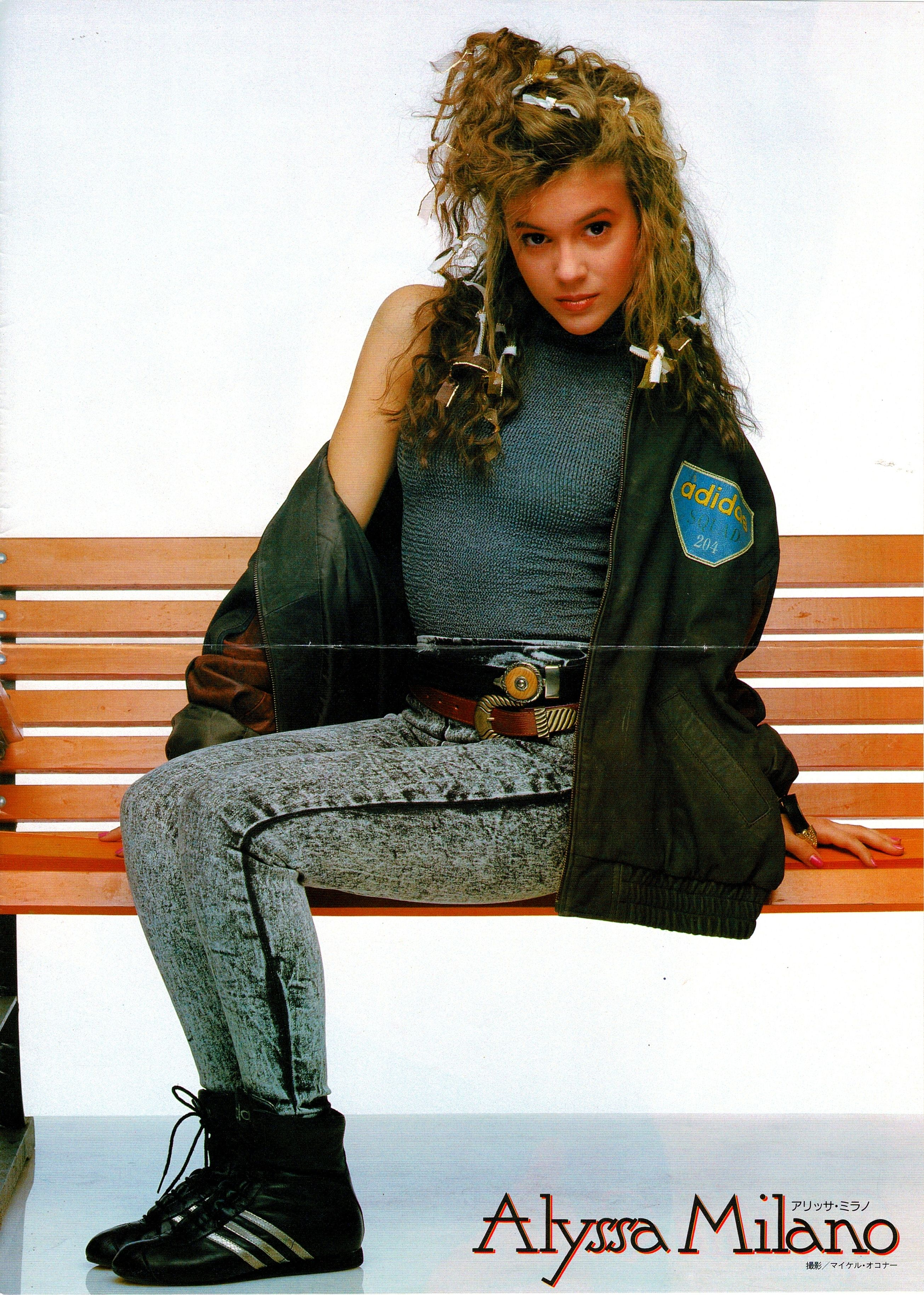 Another Shot Of Alyssa Milano Wearing A Black Leather Adidas