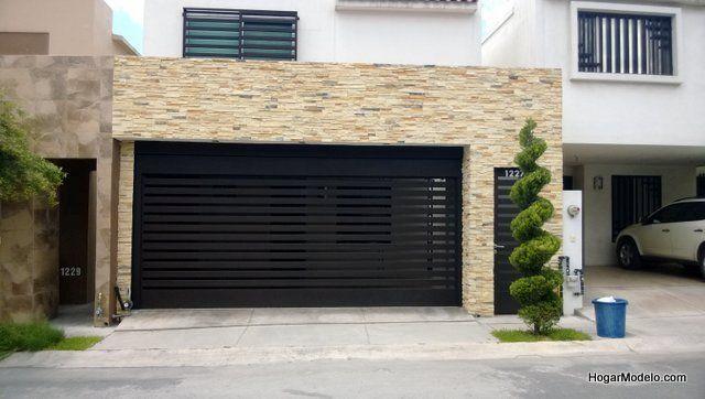 Puerta de garage de forja contempor nea con barrotes for Modelos de garajes