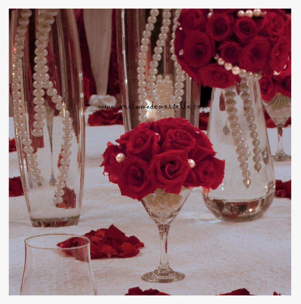 Martini centerpieces used pearls as accent pearls add an wedding decoration inspiring dining table decoration with red roses combine with glass vases and pearl chains combine with white table sheet reviewsmspy