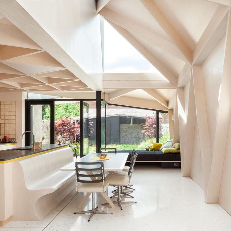 Dining Space With Terrazzo Floor Plywood Walls Skylight