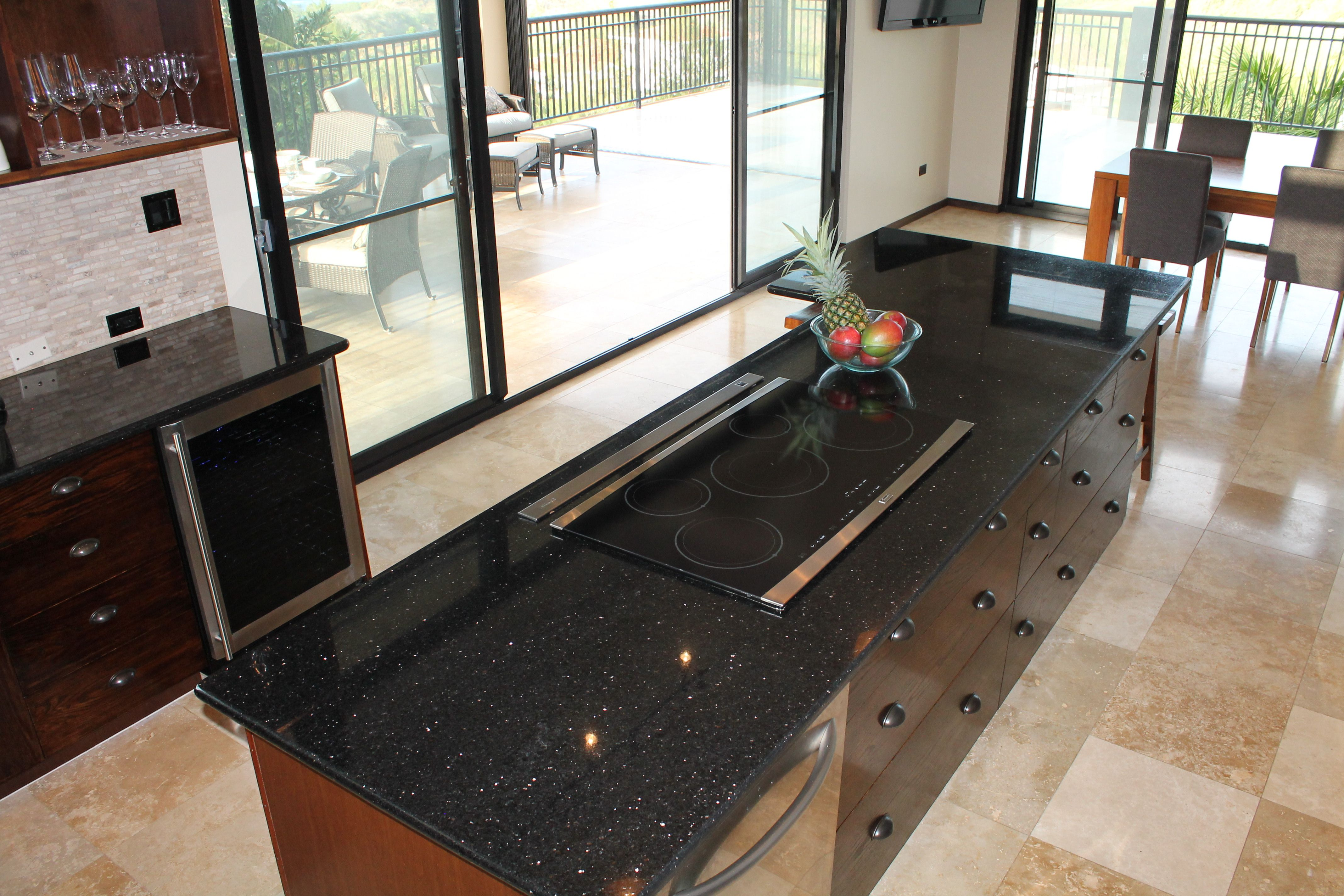 the island features a 36 inch induction cooktop and a telescoping
