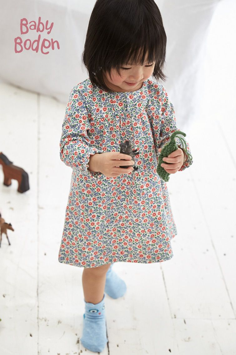 Your little mini-me can look as stylish as you with this extra cosy dress. The super-soft jersey fabric feels just like pajamas (yes, it's that comfortable) but the fun prints and pleating detail give it the added flair of a wear-all-day dress.