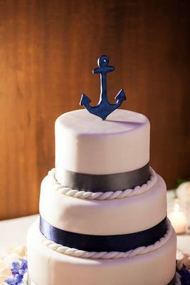 Love the charming anchor cake topper from Raquel and Jason's glam nautical wedding! (Photo by Nerinna Studios)