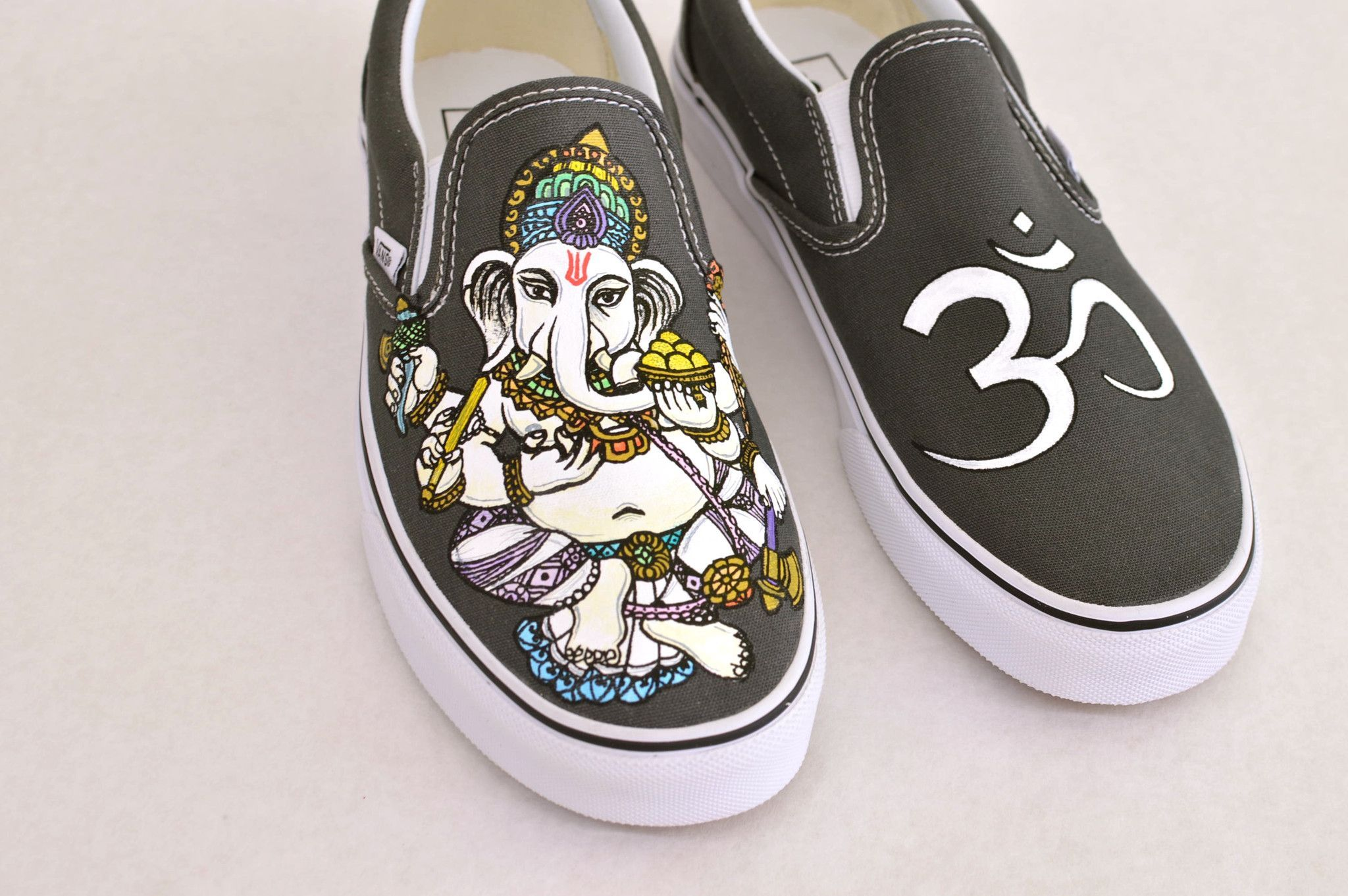 0350985c98 These one-of-a-kind hand-painted Pewter Slip-on Vans shoes feature Ganesha  the…