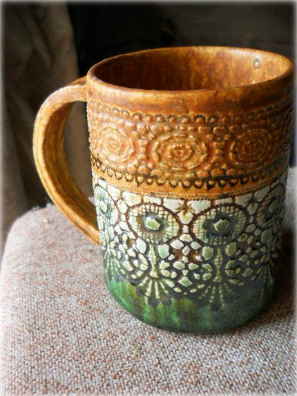 A beautiful brown and glossy green, lace imprint handmade ceramic mug. $23.00, via Etsy.