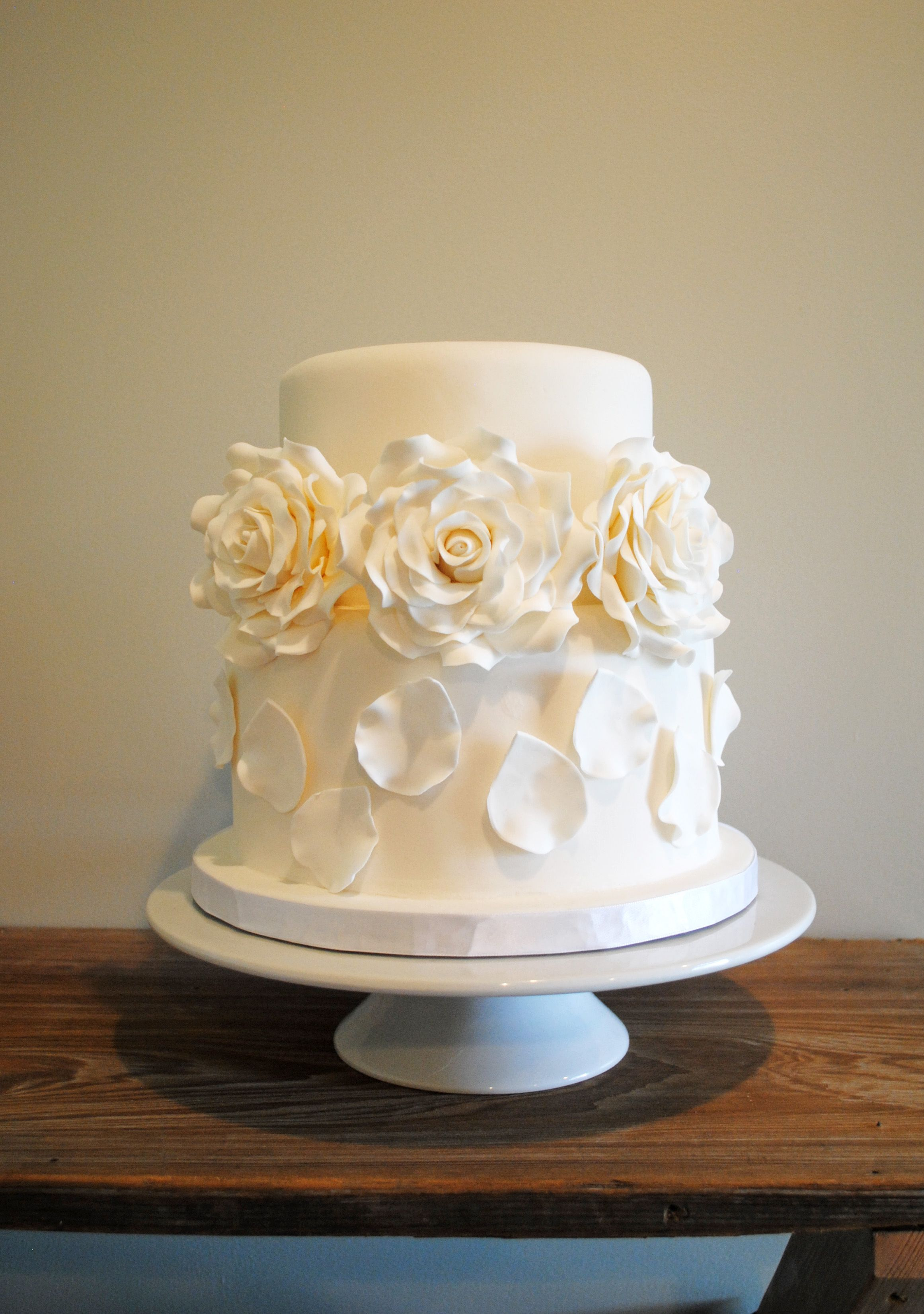 White on white cake with sugar roses and petals