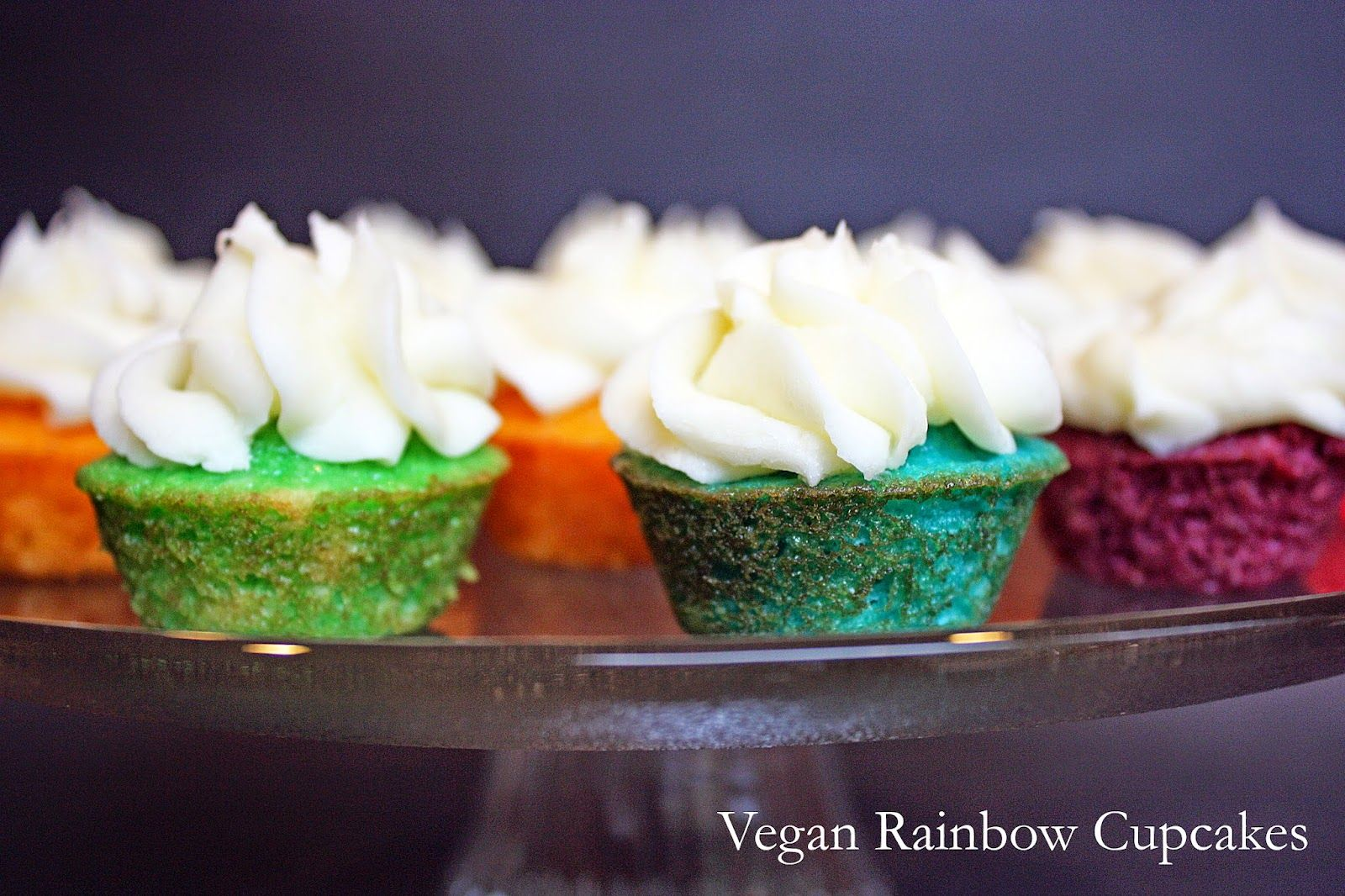 Vegan rainbow mini cupcakes with salted almond buttercream.