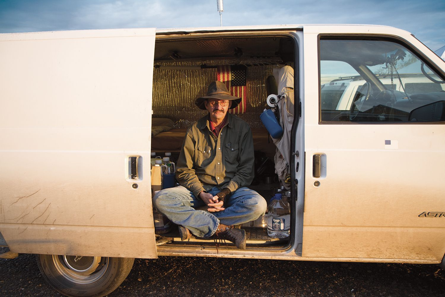 A Vandweller Known As Ghost Dancer Sits In The Vehicle He Calls Home Jessica Bruder America Nomad Road