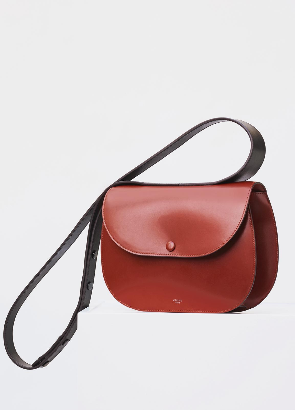 SMALL ROUND BOX SHOULDER BAG IN BURNT RED BOX CALFSKIN ADJUSTABLE STRAP.  ONE FLAT COMPARTMENT AND ONE ZIPPER POCKET INSIDE. CALFSKIN AND LAMBSKIN  LINING ... ed40bcc617595