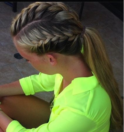 Sporty Hairdo A French Braid On Both Sides And The Top Pulled Into A Ponytail Sporty Hairstyles Volleyball Hairstyles Sports Hairstyles
