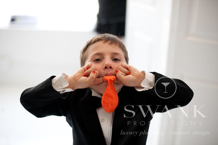 Planned, Designed & Produced by www.swankproductions.com Clean Modern Rooftop Wedding at studio 450. Kids' favors #modern #wedding #rooftop #bridal #party #ring #bearer #decor #inspiration #ideas #clean #white #orange #yellow #studio #450