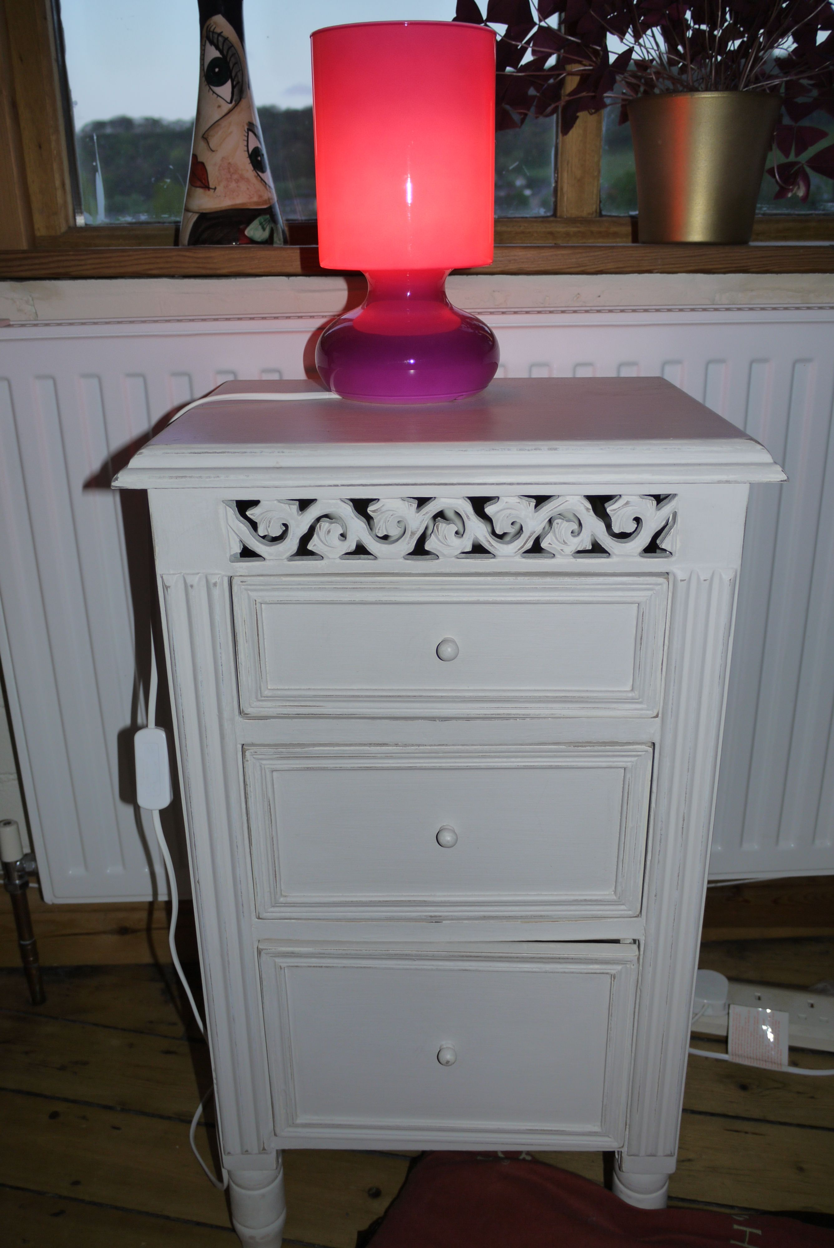 Bedside table and pink Ikea lamp