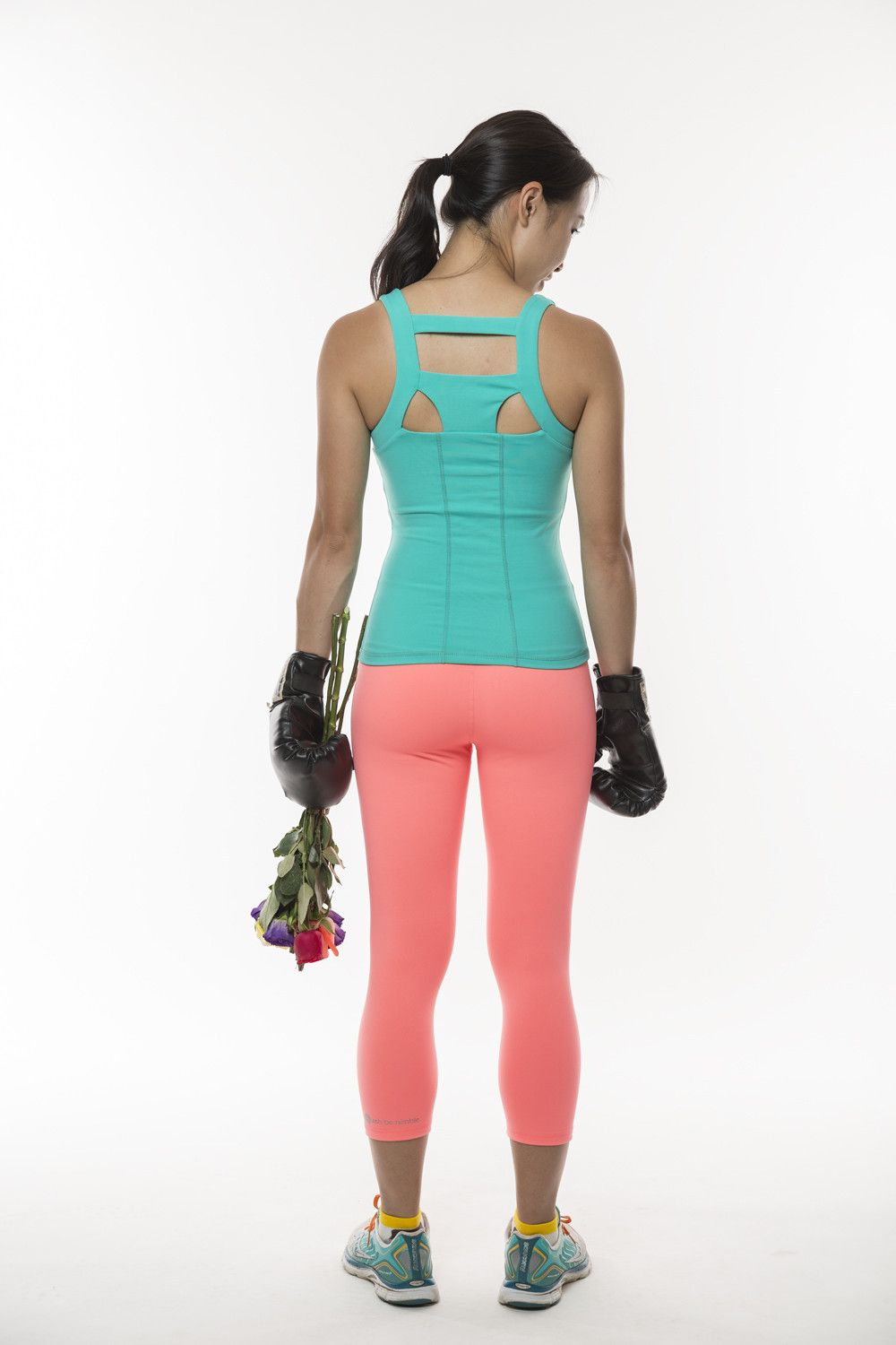 Don't-Tell Teal Support Singlet.  Need the support but hate wearing two layers of sports bra and top? Shhhh… don't tell them you're only wearing one!   This support singlet comes with a built in shelf bra!