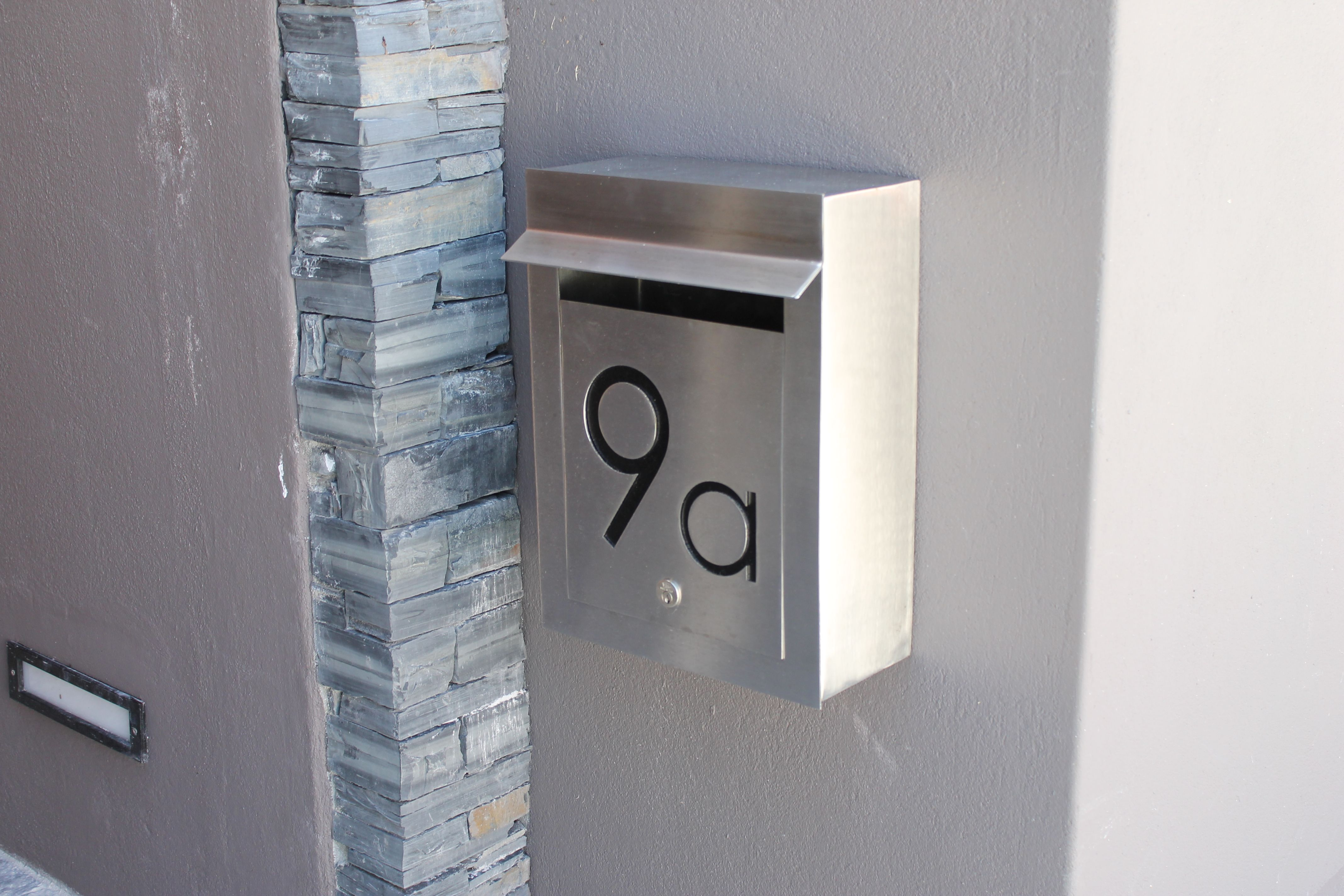 External Portrait Stainless Steel Letterbox with cut-out text in the door panel and backed & External Portrait Stainless Steel Letterbox with cut-out text in the ...