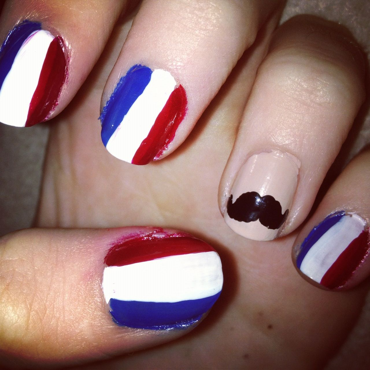 Badly done French flag nails - But I like the idea.   Nail art ...