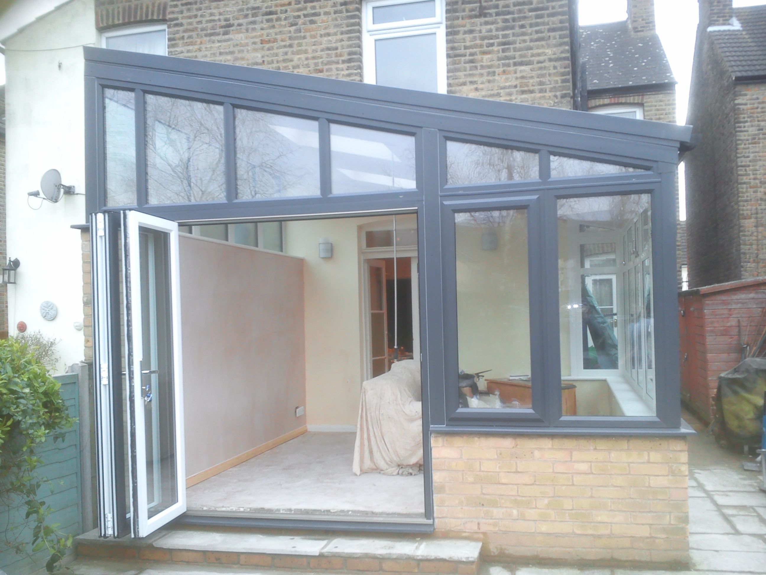 A lovely lean to aluminium conservatory with a tiled solid for Porch extension