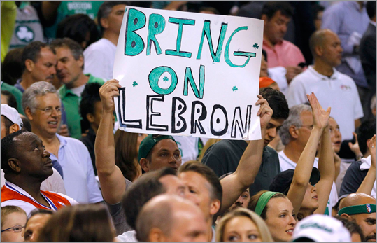 A Celtics fan held up a sign as he cheers during the fourth quarter against the 76ers.