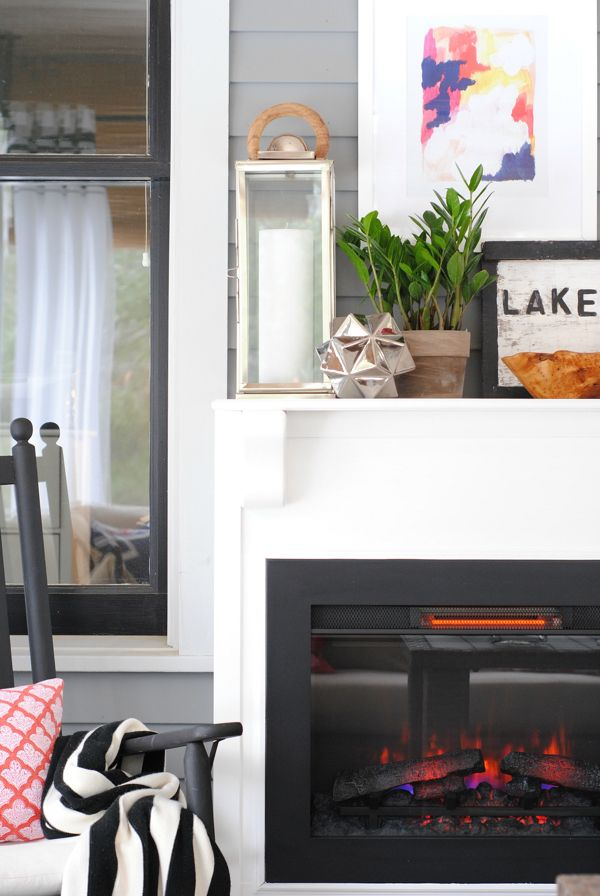 An Electric Fireplace Provides Extra Warmth On A Screened