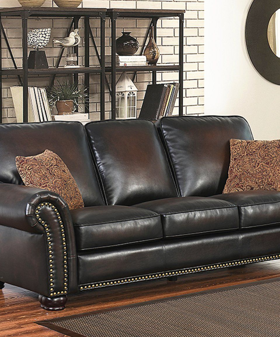 Take a look at this dark brown holden sofa u pillows today aa new