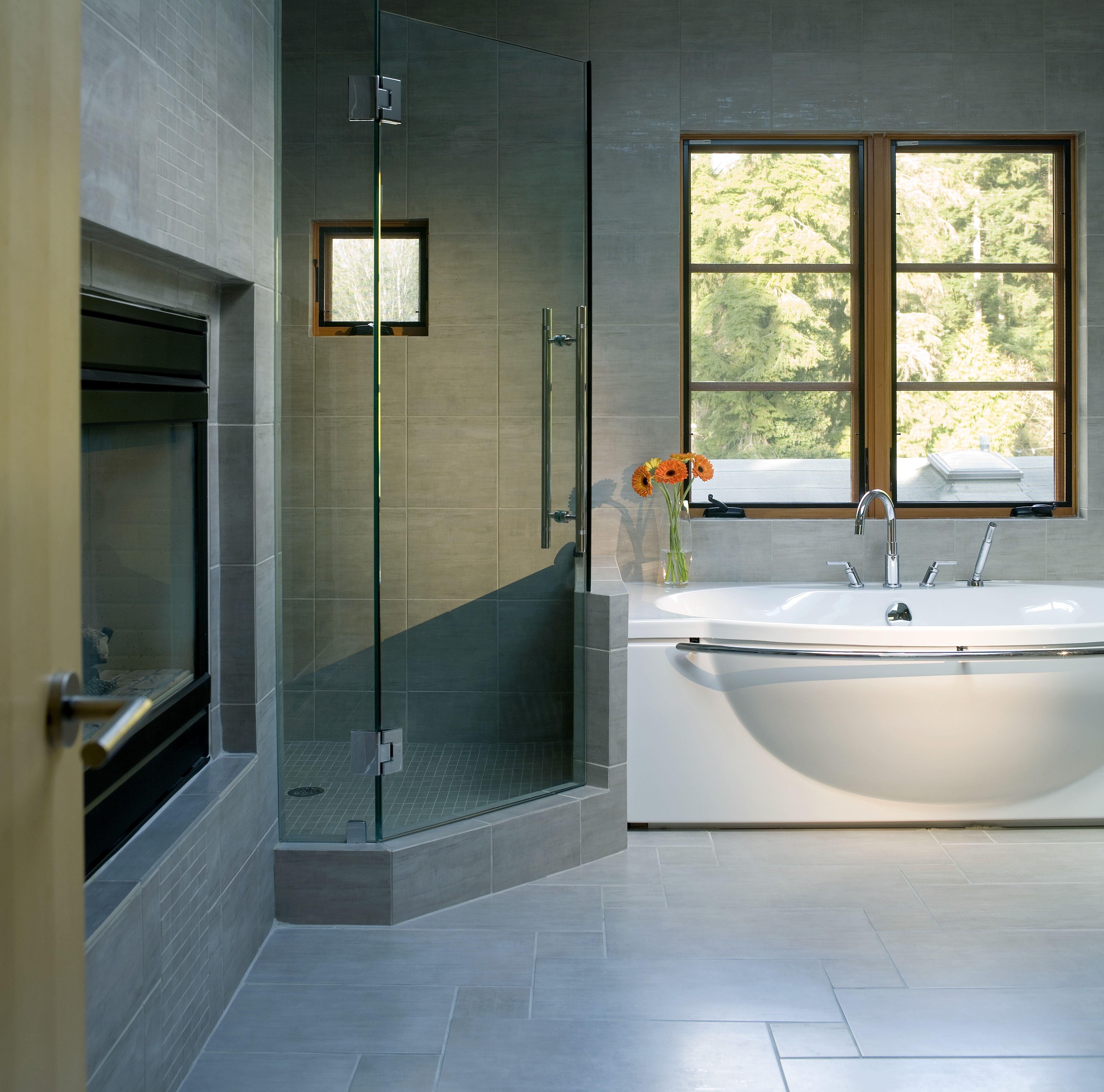 Modern Bathroom With A Corner Shower Enclosed By Gl
