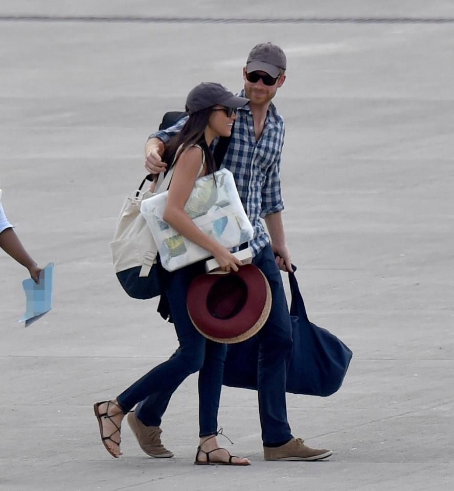 Image result for meghan markle and prince harry going on plane