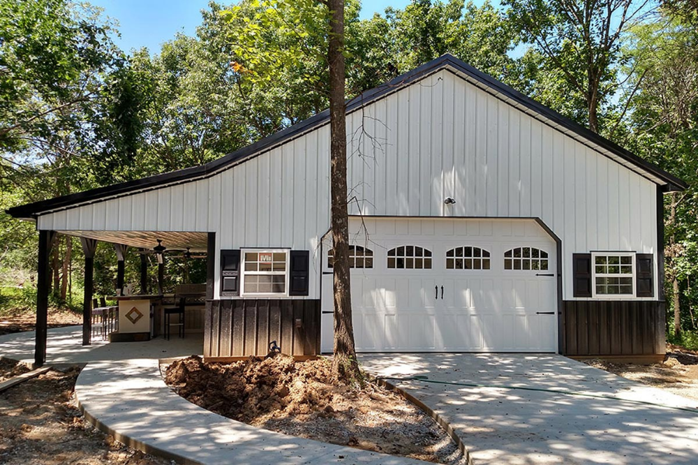 Pole Barn house built on concrete slab with 2-car garage and lean-to