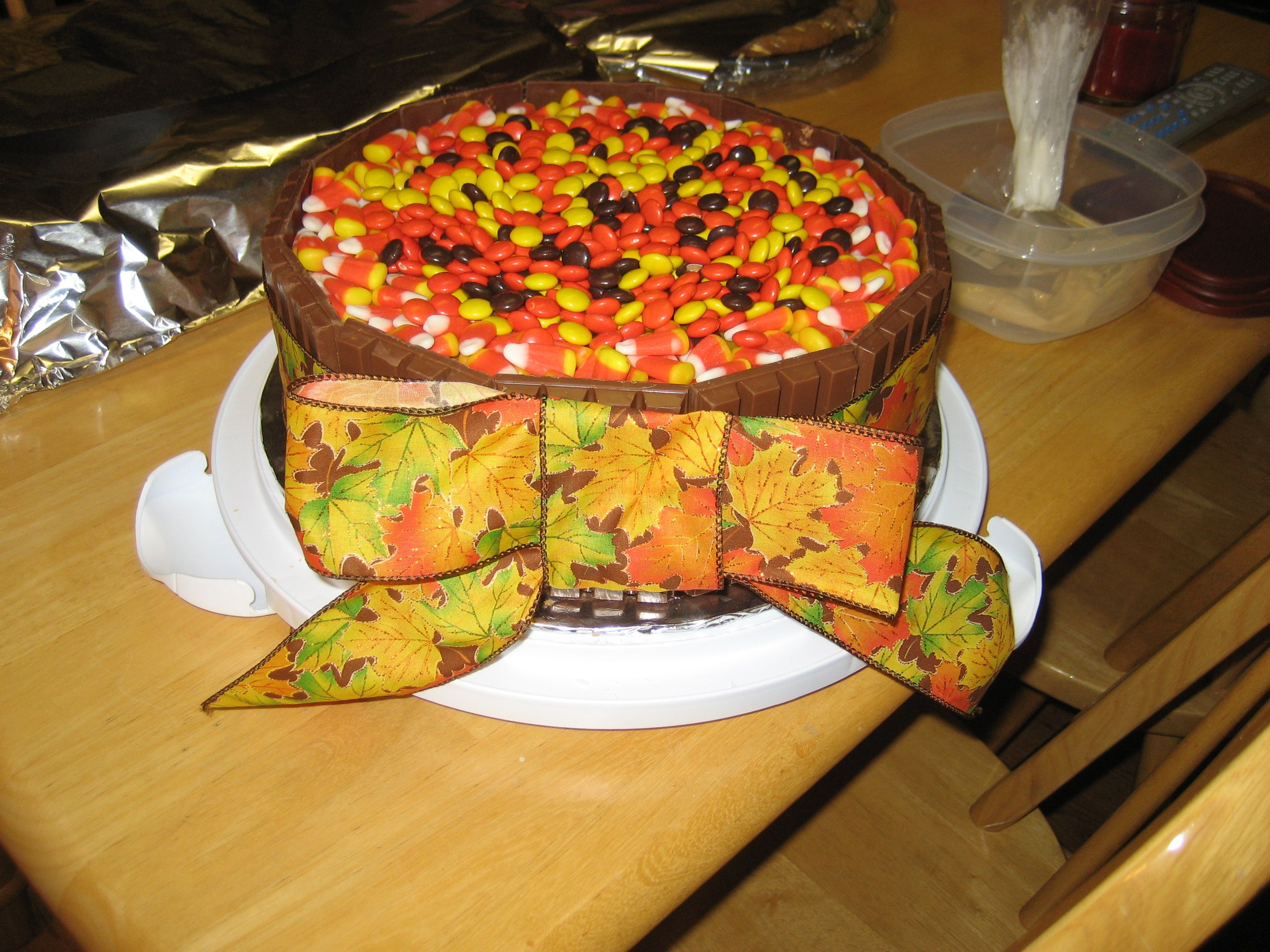 Reeces pieces, candy corn, Kit Kats. On and around the cake.
