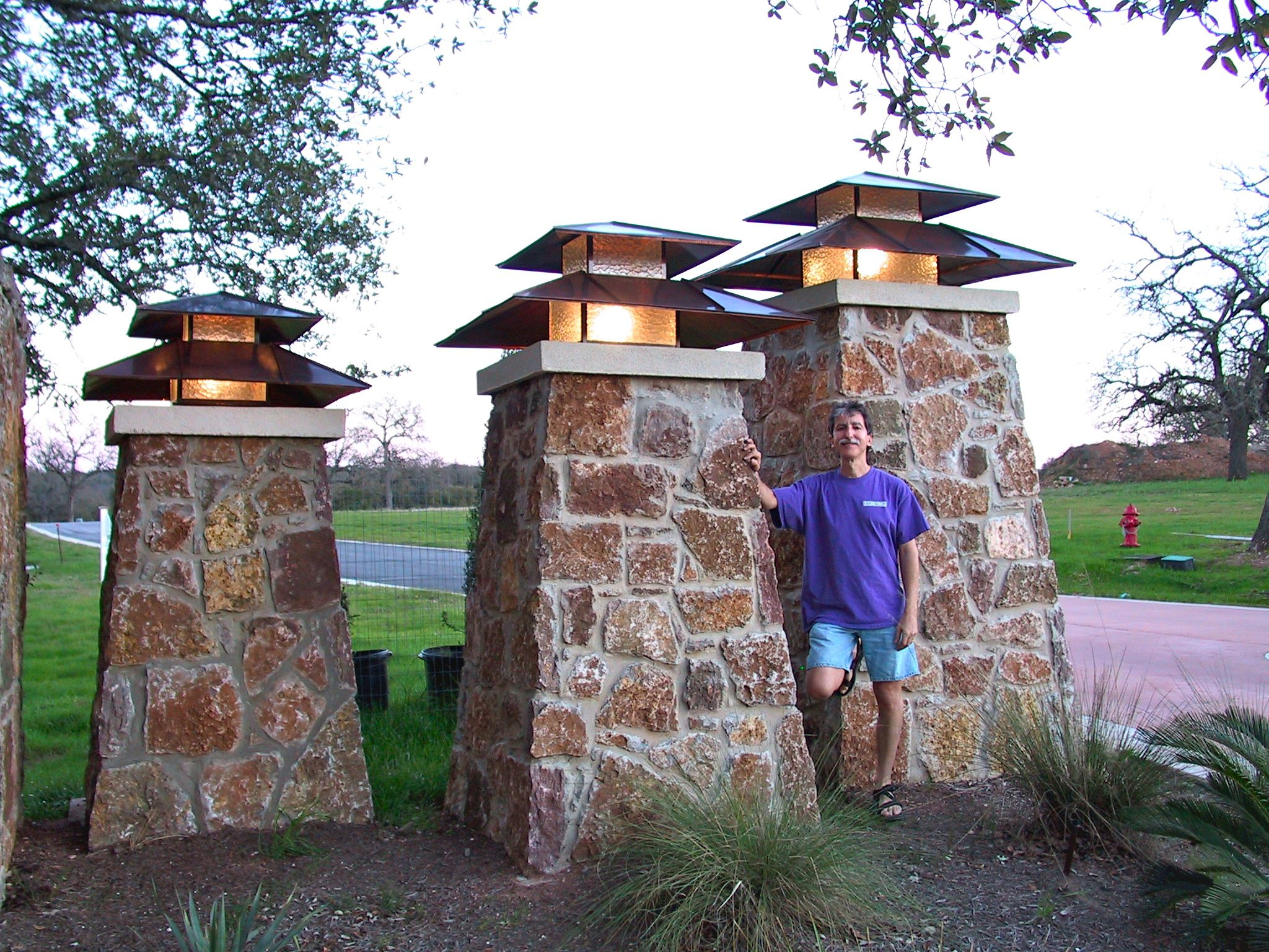 Three of thirteen lanterns at an entrance to a subdivision. | Post on subdivision home, subdivision blueprint, subdivision planning software, subdivision construction,