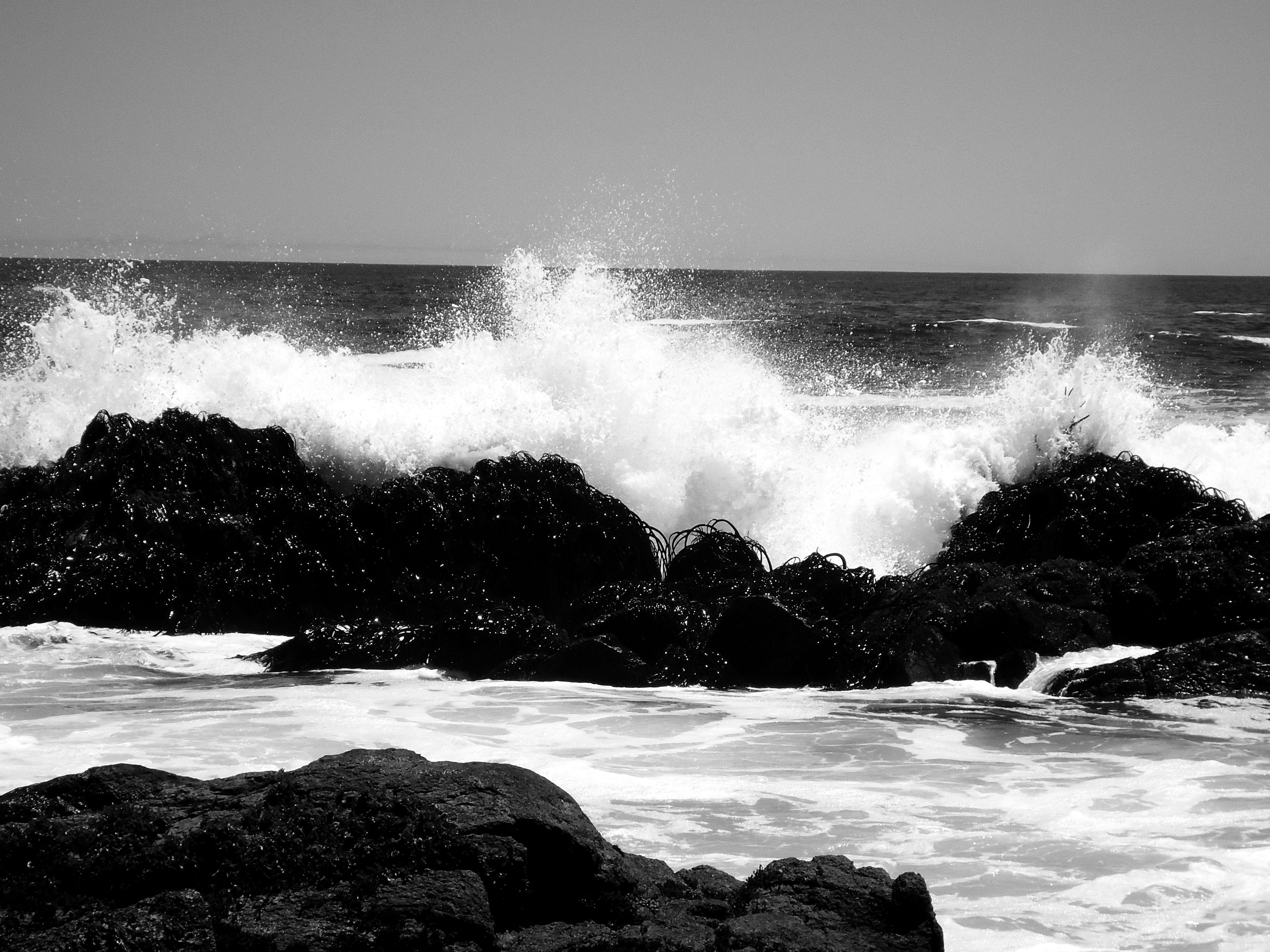 Black and white ocean waves sea rocks balance between black