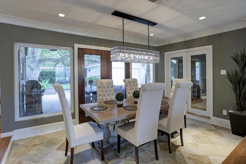 Alternate View Of The Elegant Formal Dining Room French Doors Open
