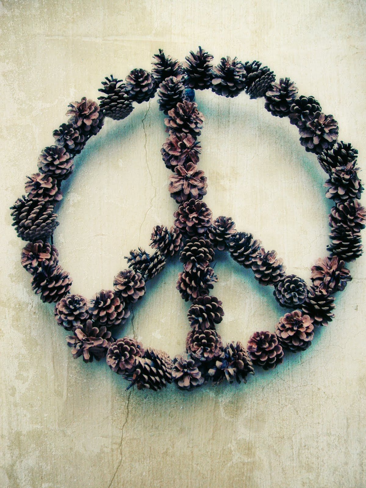 0f7e70145 DIY: peace sign wreath I LOVE this and would love to find the pine cones to  make one. Will have to see what I Can come up with.