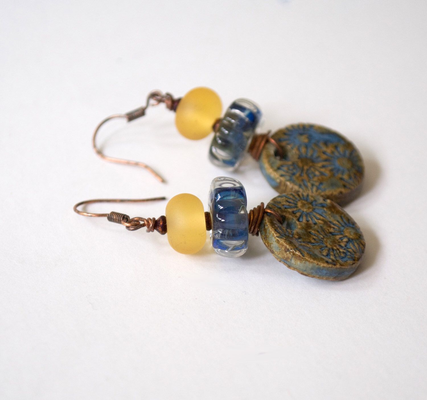 A personal favorite from my Etsy shop https://www.etsy.com/listing/460918950/floral-earrings-ceramic-earrings-blue
