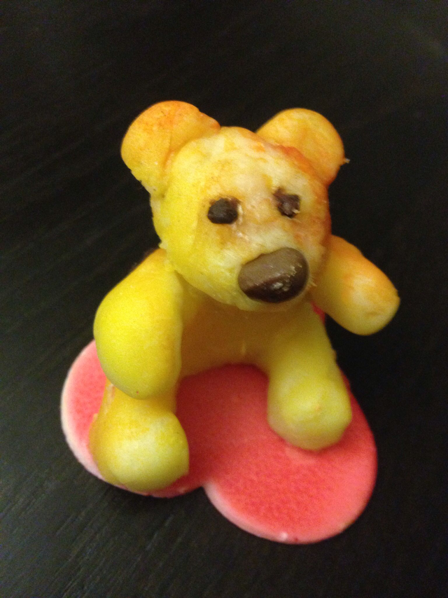 prototype of a small edible love bear I did myself ~ almond paste, chocolate kisse and a bit safran color in an airbrush were used