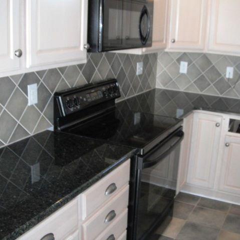 Stunning Absolute Black Granite Combined With Nice Kitchen Lamp Color Custom Kitchen Area W Gray Tile Backsplash Grey Backsplash Backsplash For White Cabinets