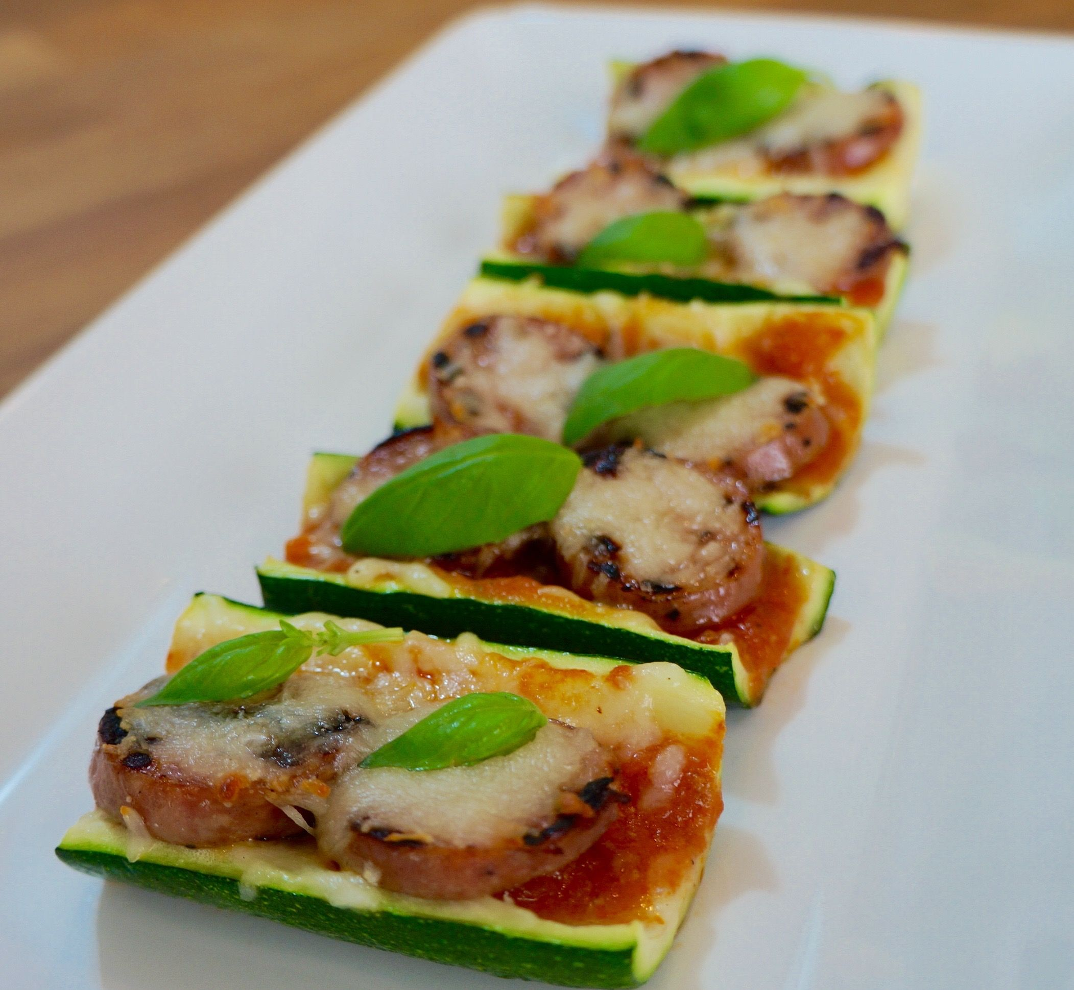 Zucchini Pizza Boats with Chicken Sausage and Basil - FlavorFinds.com  healthy recipes, diet recipes, easy recipes, dinner recipes, easy weekday recipes, low fat recipes, gluten free recipes, zucchini recipes, zucchini boat pizza recipes, chicken sausage recipes, pizza recipes, healthy pizza recipes #zucchini
