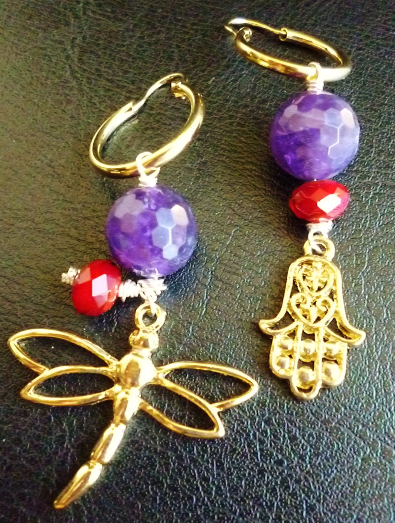 gold filled earrings with purple agate, red crystal, gold filled dragonfly and hand of Fatima $30