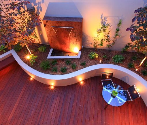Add Curves Make Your Decking Playful By Adding A Curved Planter Area Garden Decking Ideas Outdoor Backyard Deck Lighting Deck Garden