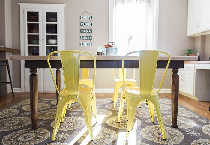 Serve breakfast sunny side up with these cheerful yellow chairs. A muted rug with hints of gold ties the whole room together.